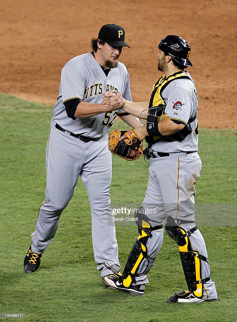 <a gi-track='captionPersonalityLinkClicked' href=/galleries/search?phrase=Joel+Hanrahan&family=editorial&specificpeople=2527864 ng-click='$event.stopPropagation()'>Joel Hanrahan</a> #52 of the Pittsburgh Pirates celebrates with <a gi-track='captionPersonalityLinkClicked' href=/galleries/search?phrase=Rod+Barajas&family=editorial&specificpeople=211198 ng-click='$event.stopPropagation()'>Rod Barajas</a> #26 after a game against the Miami Marlins at Marlins Park on May 14, 2012 in Miami, Florida. The Pirates defeated the Marlins 3-2.