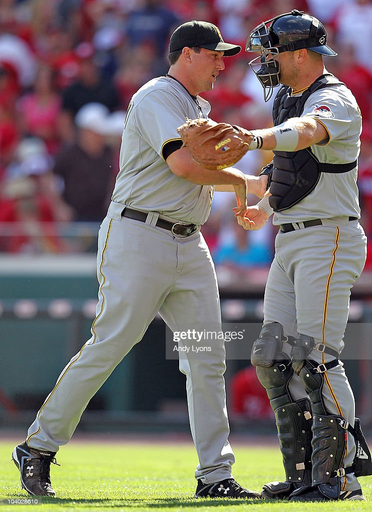 <a gi-track='captionPersonalityLinkClicked' href=/galleries/search?phrase=Joel+Hanrahan&family=editorial&specificpeople=2527864 ng-click='$event.stopPropagation()'>Joel Hanrahan</a> #52 of the Pittsburgh Pirates is congratulated by Ryan Doumit #41 after the Pirates 3-1 win over the Cincinnati Reds at Great American Ballpark on September 12, 2010 in Cincinnati, Ohio.