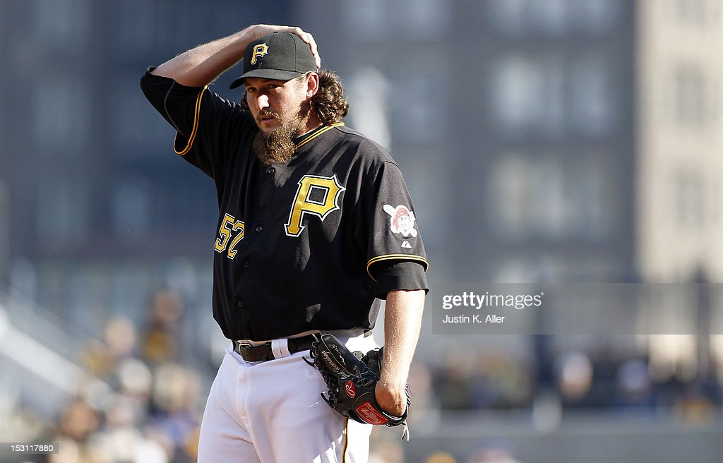 <a gi-track='captionPersonalityLinkClicked' href=/galleries/search?phrase=Joel+Hanrahan&family=editorial&specificpeople=2527864 ng-click='$event.stopPropagation()'>Joel Hanrahan</a> #52 of the Pittsburgh Pirates reacts after giving up a home run in the ninth inning against the Cincinnati Reds during the game on September 30, 2012 at PNC Park in Pittsburgh, Pennsylvania. The Reds defeated the Pirates 4-3.