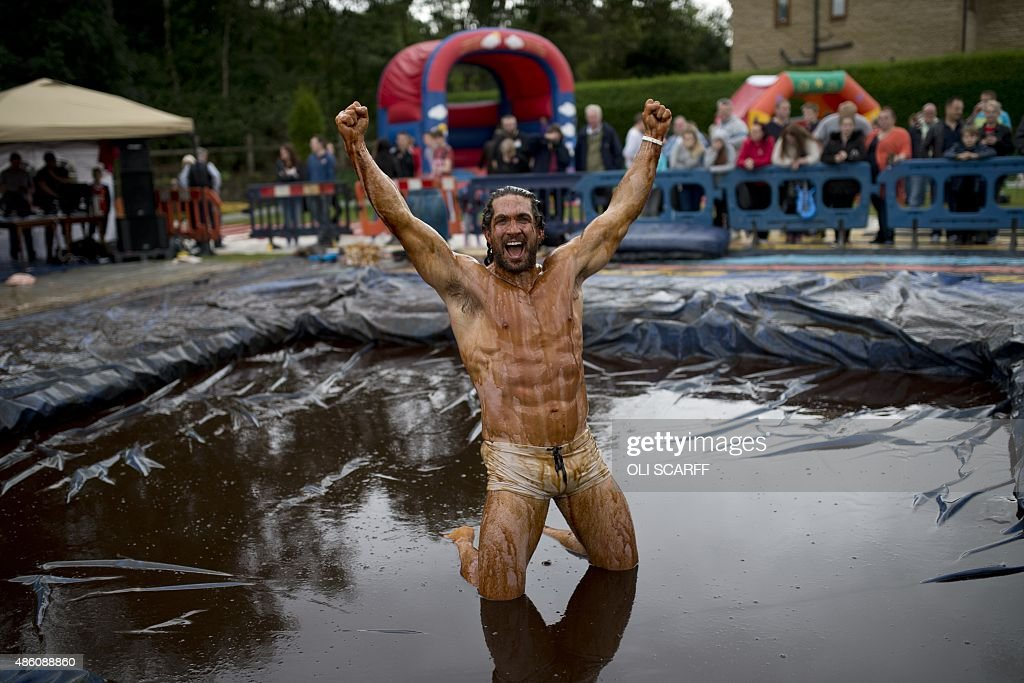 Joel Hicks celebrates winning the men's title in the 8th annual World Gravy Wrestling Championships at the Rose n Bowl Pub in Bacup north west...