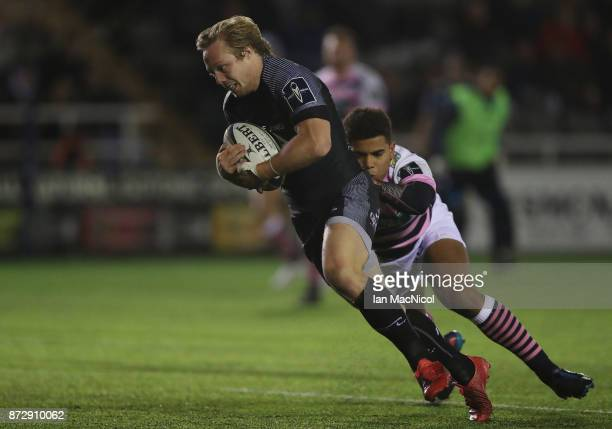 Joel Hodgson of Newcastle Falcons runs through to score this teams eighth try of the game during the AngloWelsh Cup match between Newcastle Falcons...
