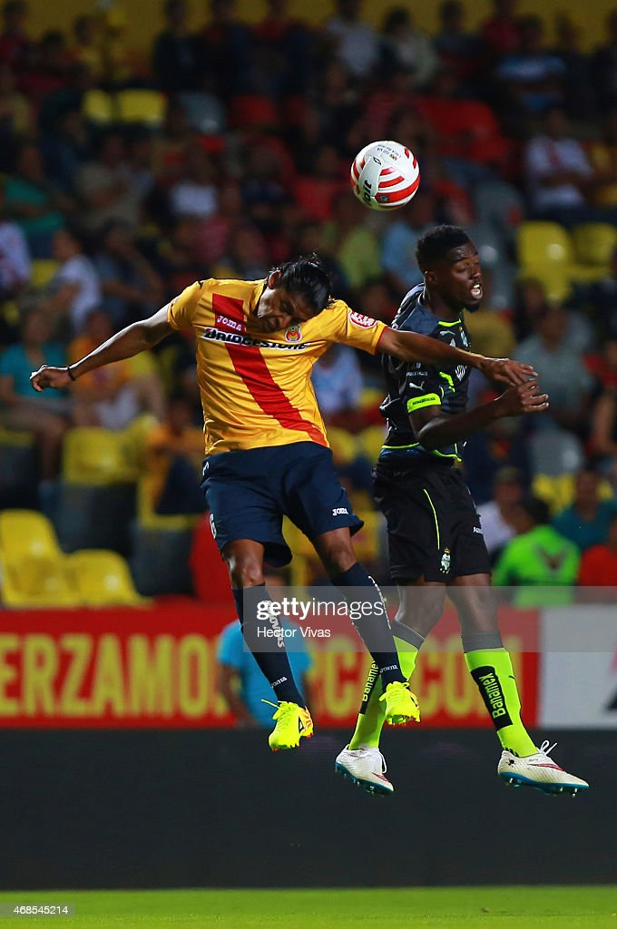 <a gi-track='captionPersonalityLinkClicked' href=/galleries/search?phrase=Joel+Huiqui&family=editorial&specificpeople=875917 ng-click='$event.stopPropagation()'>Joel Huiqui</a> of Morelia (L) jumps for the ball with Jorge Tavares of Santos Laguna (R) during a match between Morelia and Santos Laguna as part of 12th round of Clausura 2015 Liga MX at Morelos Stadium on April 03, 2015 in Morelia, Mexico.