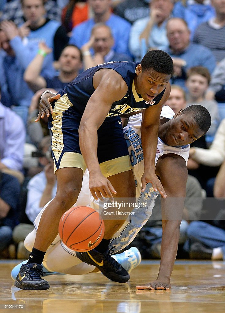 Joel James #42 of the North Carolina Tar Heels battles Chris Jones #12 of the Pittsburgh Panthers for a loose ball during their game at the Dean Smith Center on February 14, 2016 in Chapel Hill, North Carolina.