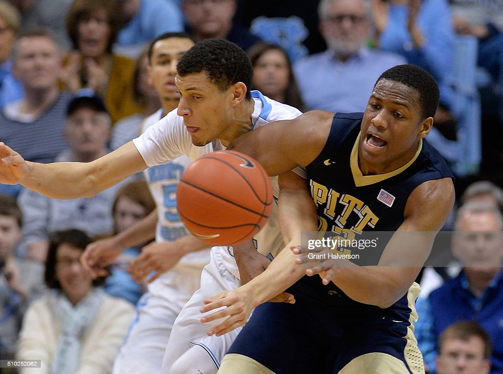 Joel James #42 of the North Carolina Tar Heels battles Chris Jones #12 of the Pittsburgh Panthers for a loose ball during their game at the Dean Smith Center on February 14, 2016 in Chapel Hill, North Carolina. North Carolina won 85-64.