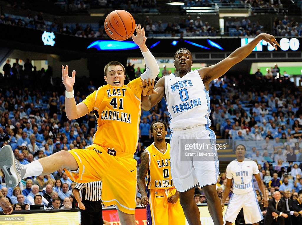 Joel James #0 of the North Carolina Tar Heels battles for a long rebound with Marshall Guilmette #41 of the East Carolina Pirates during play at the Dean Smith Center on December 15, 2012 in Chapel Hill, North Carolina. North Carolina won 93-87.