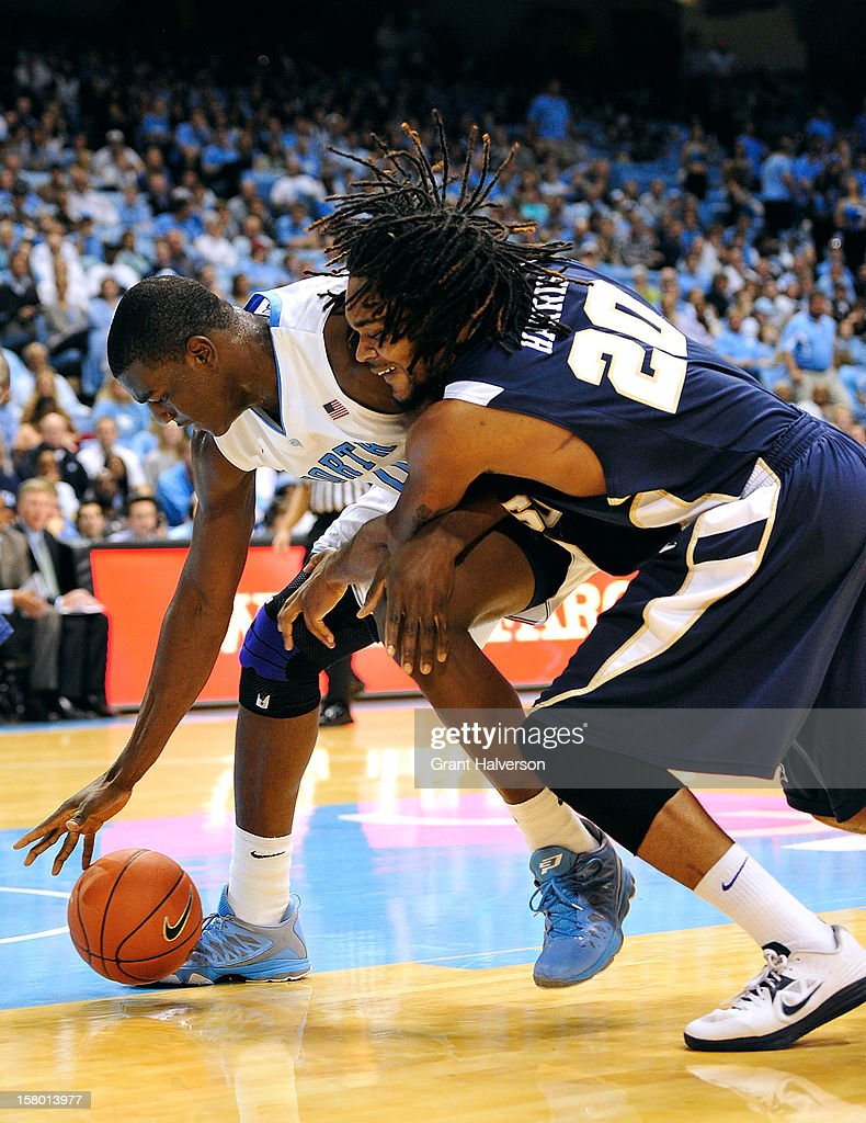 Joel James #0 of the North Carolina Tar Heels battles for a loose ball with Hunter Harris #20 of the East Tennessee State Buccaneers during play at Dean Smith Center on December 8, 2012 in Chapel Hill, North Carolina. North Carolina won 78-55.