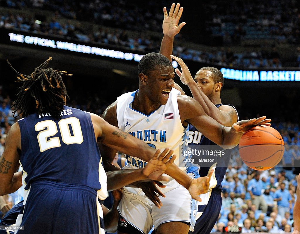 Joel James #0 of the North Carolina Tar Heels battles for a rebound with Hunter Harris #20 of the East Tennessee State Buccaneers during play at Dean Smith Center on December 8, 2012 in Chapel Hill, North Carolina. North Carolina won 78-55.