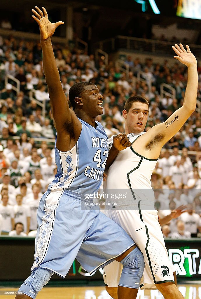 Joel James #42 of the North Carolina Tar Heels battles for position with Kenny Kaminski #30 of the Michigan State Spartans during the first half at the Jack T. Breslin Student Events Center on December 4, 2013 in East Lansing, Michigan. North Carolina won the game 79-65.
