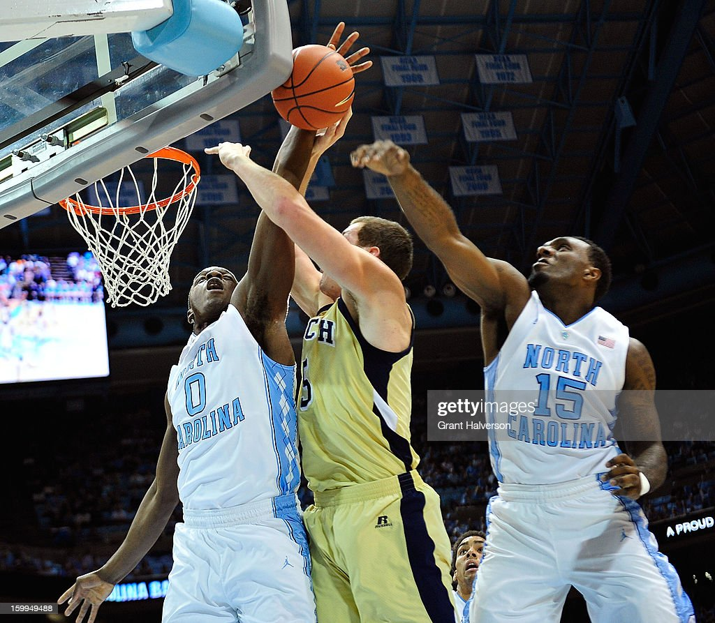 Joel James #0 of the North Carolina Tar Heels blocks a shot by Daniel Miller #5 of the Georgia Tech Yellow Jackets during play at the Dean Smith Center on January 23, 2013 in Chapel Hill, North Carolina.