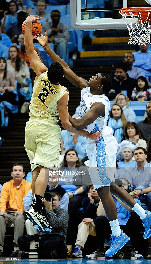 Joel James #0 of the North Carolina Tar Heels challenges a shot by Devin Thomas #2 of the Wake Forest Demon Deacons during play at the Dean Smith Center on February 5, 2013 in Chapel Hill, North Carolina. North Carolina won 87-62.