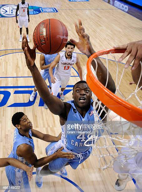 Joel James of the North Carolina Tar Heels goes up for the ball against the Virginia Cavaliers during the semifinals of the 2015 ACC Basketball...