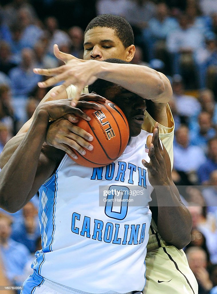 Joel James #0 of the North Carolina Tar Heels is fouled by Andre Washington #31 of the Wake Forest Demon Deacons during play at the Dean Smith Center on February 5, 2013 in Chapel Hill, North Carolina. North Carolina won 87-62.