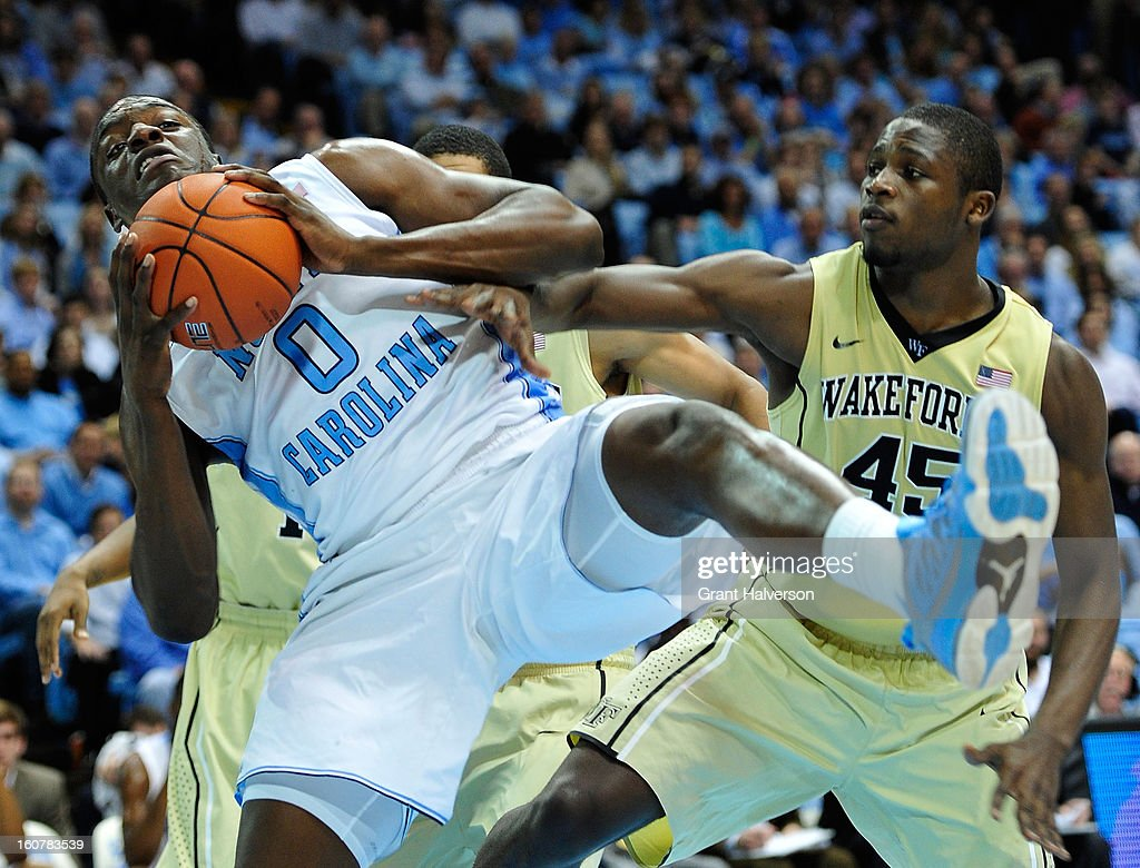 Joel James #0 of the North Carolina Tar Heels rebounds against Arnaud William Adala Moto #45 of the Wake Forest Demon Deacons during play at the Dean Smith Center on February 5, 2013 in Chapel Hill, North Carolina. North Carolina won 87-62.