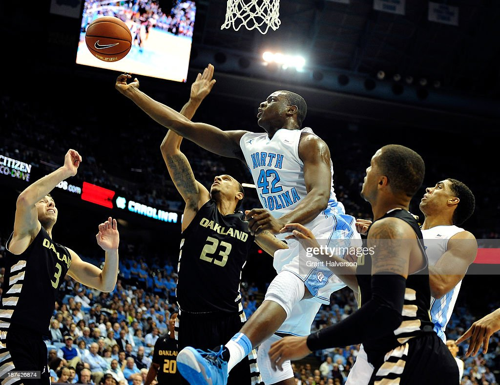 Joel James #42 of the North Carolina Tar Heels tips a rebound away from Tommie McCune #23 of the Oakland Golden Grizzlies during play at the Dean Smith Center on November 8, 2013 in Chapel Hill, North Carolina. North Carolina won 84-61.