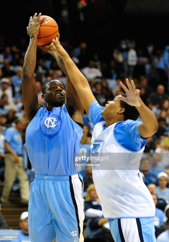 Joel James #42 shoots over teammate Kennedy Meeks #3 of the North Carolina Tar Heels during Late Night with Roy Williams at the Dean Smith Center on October 25, 2013 in Chapel Hill, North Carolina.