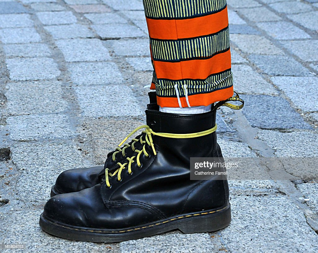 Joel Jay-P Stylist wearing original black Doc Martens with orange ,black and white striped Dent de Man trousers, at London Fashion Week Fall/Winter 2013/14 on February 15, 2013 in London, England.