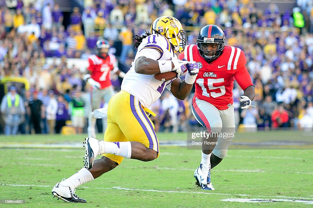 Joel Kight #15 of the Ole Miss Rebels pursues Spencer Ware #11 of the LSU Tigers during a game at Tiger Stadium on November 17, 2012 in Baton Rouge, Louisiana.