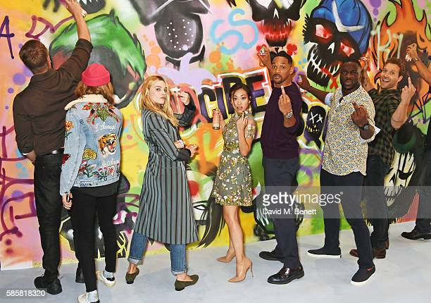 Joel Kinnaman Cara Delevingne Margot Robbie Karen Fukuhara Will Smith Adewale AkinnuoyeAgbaje Jai Courtney and the cast of 'Suicide Squad' put the...