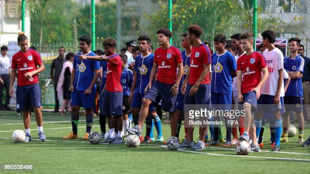 Joel Latibeaudiere Angel Gomes Jadon Sancho Daniel Loader and George McEachran of England play football with young children from the Kolkata Outreach...