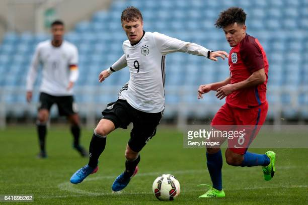 Joel Latibeaudiere of England U17 challenges JannFiete Arp of Germany U17 during the U17 Algarve Cup Tournament Match between England U17 and Germany...