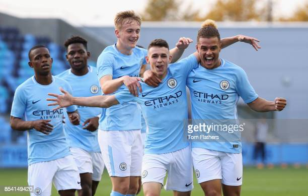 Joel Latibeaudiere of Manchester City celebrates with team mates as he scores their first goal during the UEFA Youth League Group F match between...