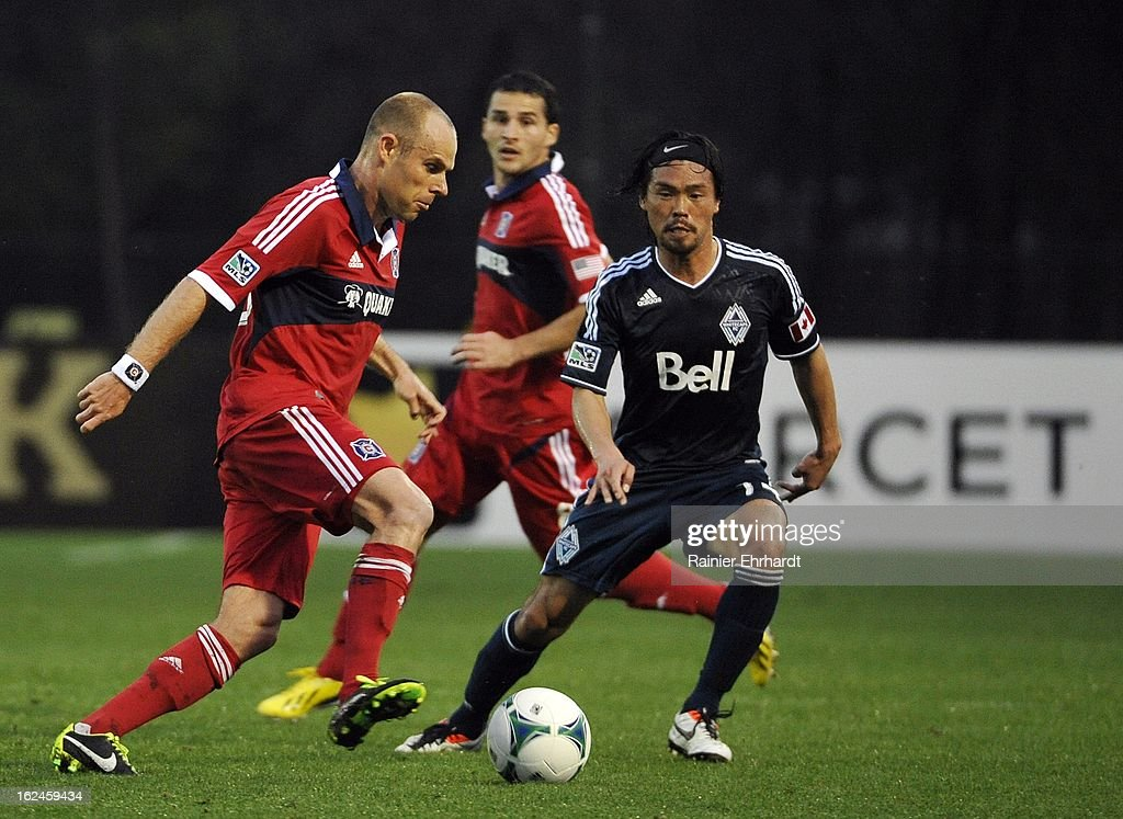 Joel Lindpere #26 of the Chicago Fire and Daigo Kobayashi #14 of the Vancouver Whitecaps FC battle for the ball during the first half of a game at Blackbaud Stadium on February 23, 2013 in Charleston, South Carolina.