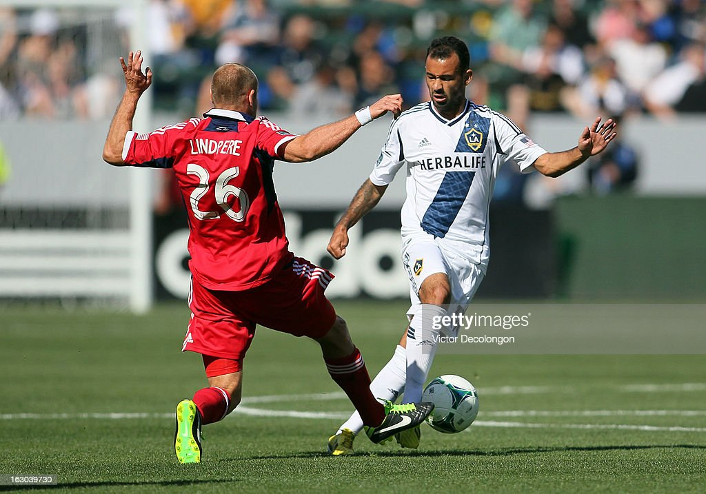 Joel Lindpere #26 of the Chicago Fire defends Juninho #19 of the Los Angeles Galaxy during the MLS match at The Home Depot Center on March 3, 2013 in Carson, California. The Galaxy defeated the Fire 4-0.