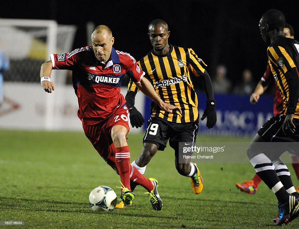 Joel Lindpere #26 of the Chicago Fire moves the ball as Dane Kelly #9 of the Charleston Battery defends during the first half of a game at Blackbaud Stadium on February 20, 2013 in Charleston, North Carolina.
