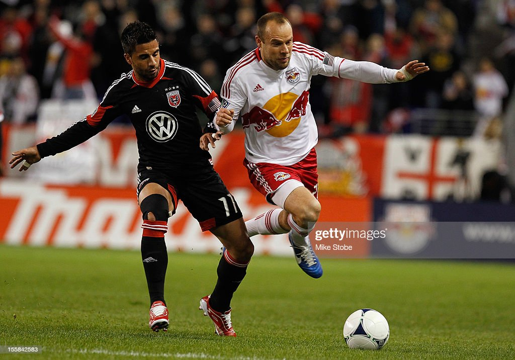 Joel Lindpere #20 of the New York Red Bulls and <a gi-track='captionPersonalityLinkClicked' href=/galleries/search?phrase=Marcelo+Saragosa&family=editorial&specificpeople=178311 ng-click='$event.stopPropagation()'>Marcelo Saragosa</a> #11 of DC United vie for the ball during the Eastern Conference Semifinals at Red Bull Arena on November 7, 2012 in Harrison, New Jersey. DC United defeated the New York Red Bulls 1-0.