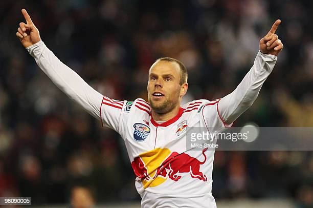 Joel Lindpere of the New York Red Bulls celebrates his goal in the 40th minute against the Chicago Fire on March 27 2010 at Red Bull Arena in...