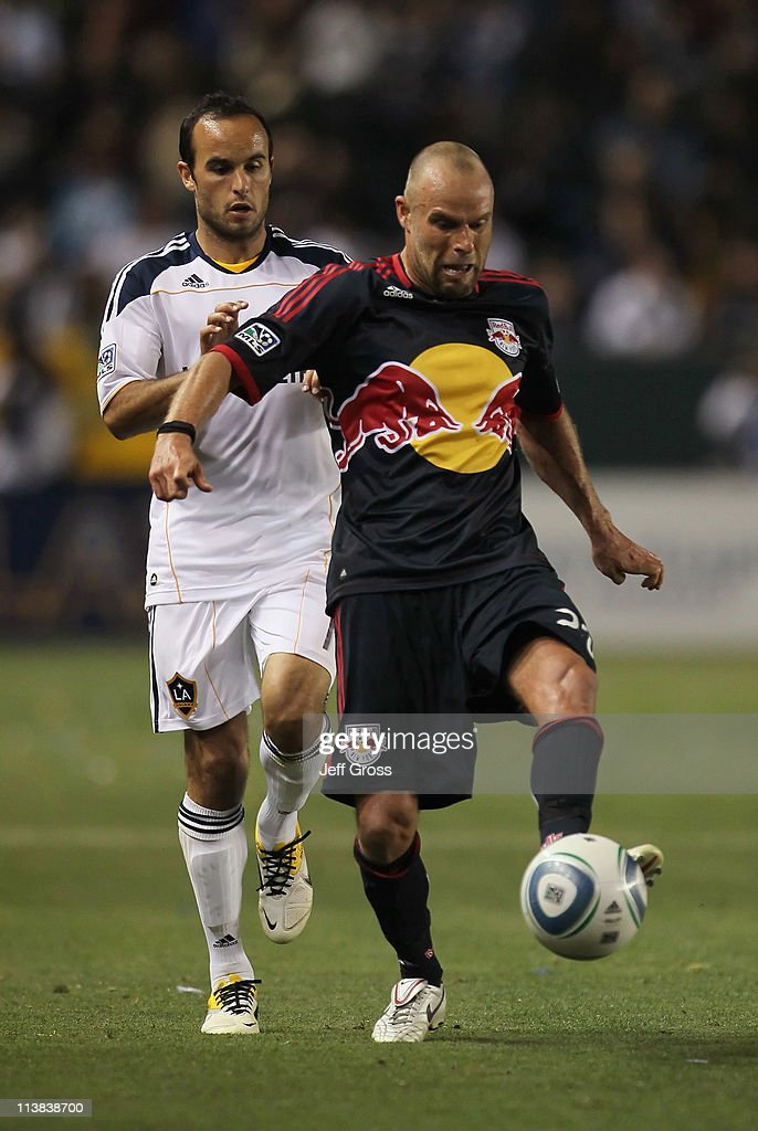 Joel Lindpere #20 of the New York Red Bulls is pursued by <a gi-track='captionPersonalityLinkClicked' href=/galleries/search?phrase=Landon+Donovan&family=editorial&specificpeople=171601 ng-click='$event.stopPropagation()'>Landon Donovan</a> #10 of the Los Angeles Galaxy for the ball in the second half at The Home Depot Center on May 7, 2011 in Carson, California. The Red Bulls and Galaxy played to a 1-1 draw.