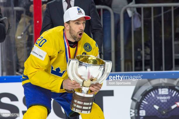 Joel Lundqvist celebrates with the trophy after the Ice Hockey World Championship Gold medal game between Canada and Sweden at Lanxess Arena in...