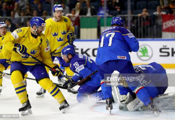 Joel Lundqvist of Sweden fails to score over Frederic Cloutier goaltender of Italy for the puck during the 2017 IIHF Ice Hockey World Championship...