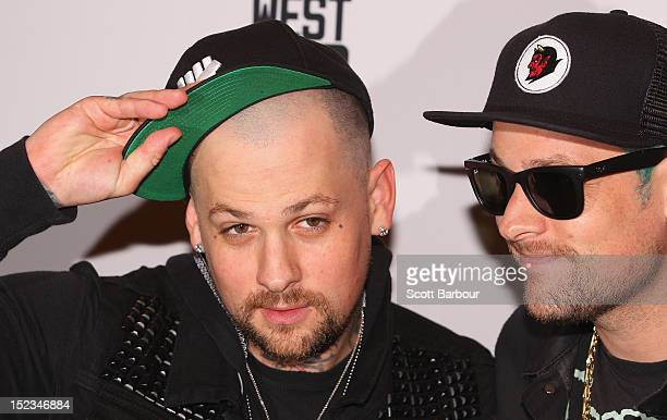 Joel Madden and Benji Madden of Good Charlotte attend Footy at The West End on September 19 2012 in Melbourne Australia