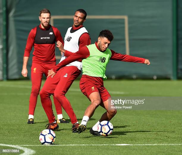 Joel Matip and Alex OxladeChamberlain of Liverpool during a training session at Melwood Training Ground on October 12 2017 in Liverpool England