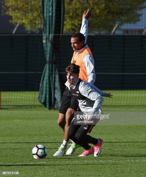 Joel Matip and Ben Woodburn of Liverpool during a training session at Melwood Training Ground on April 11 2017 in Liverpool England