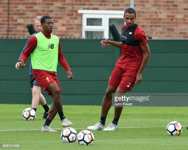Joel Matip and Georginio Wijnaldum of Liverpool during a training session at Melwood Training Ground on August 10 2017 in Liverpool England