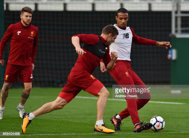 Joel Matip and James Milner of Liverpool during a training session at Melwood Training Ground on October 9 2017 in Liverpool England