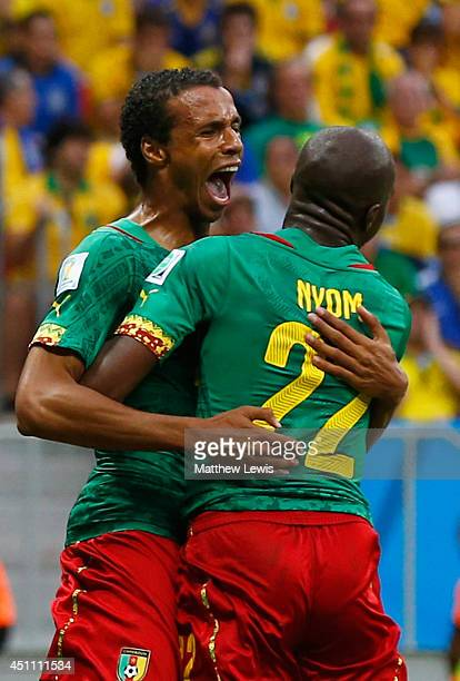 Joel Matip of Cameroon celebrates scoring his team's first goal with Allan Nyom during the 2014 FIFA World Cup Brazil Group A match between Cameroon...
