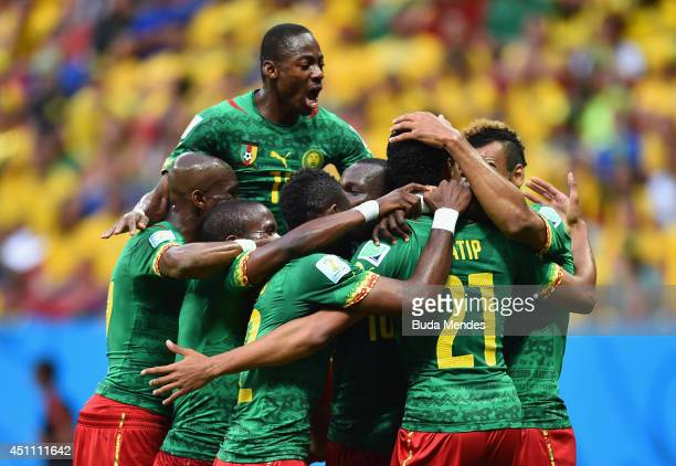 Joel Matip of Cameroon celebrates scoring his team's first goal with teammates during the 2014 FIFA World Cup Brazil Group A match between Cameroon...