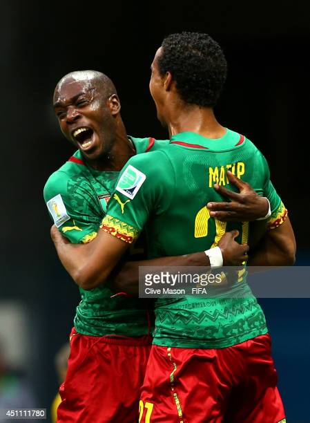 Joel Matip of Cameroon celebrates scoring his team's first goal with his teammate Allan Nyom during the 2014 FIFA World Cup Brazil Group A match...