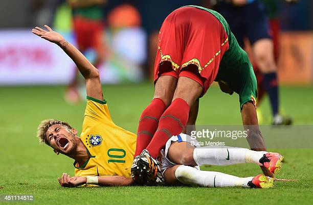 Joel Matip of Cameroon collides with Neymar of Brazil during the 2014 FIFA World Cup Brazil Group A match between Cameroon and Brazil at Estadio...