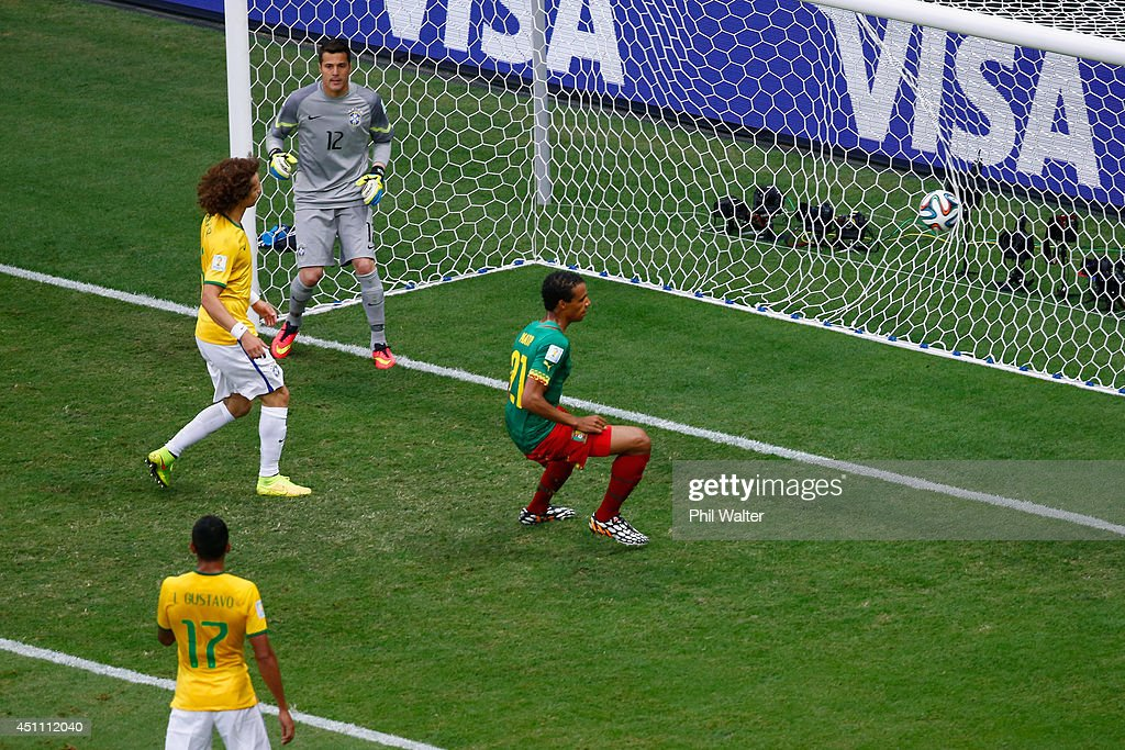 <a gi-track='captionPersonalityLinkClicked' href=/galleries/search?phrase=Joel+Matip&family=editorial&specificpeople=4462851 ng-click='$event.stopPropagation()'>Joel Matip</a> of Cameroon scores his team's first goal past Julio Cesar of Brazil during the 2014 FIFA World Cup Brazil Group A match between Cameroon and Brazil at Estadio Nacional on June 23, 2014 in Brasilia, Brazil.