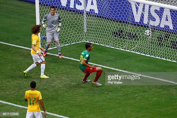 Joel Matip of Cameroon scores his team's first goal past Julio Cesar of Brazil during the 2014 FIFA World Cup Brazil Group A match between Cameroon...