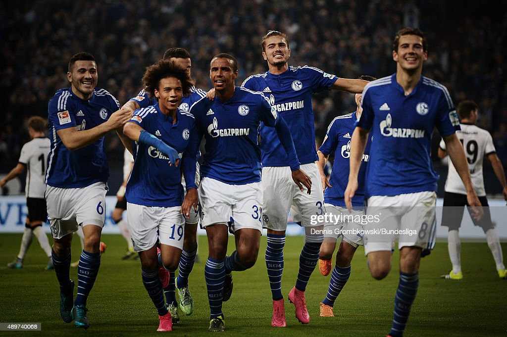 Joel Matip of FC Schalke 04 celebrates with team mates as he scores the first goal during the Bundesliga match between FC Schalke 04 and Eintracht Frankfurt at Veltins-Arena on September 23, 2015 in Gelsenkirchen, Germany.