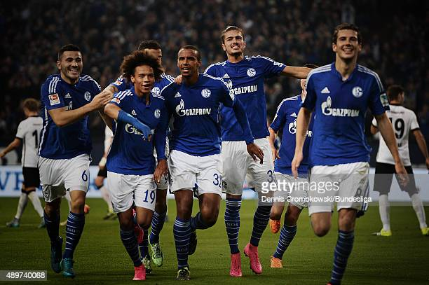 Joel Matip of FC Schalke 04 celebrates with team mates as he scores the first goal during the Bundesliga match between FC Schalke 04 and Eintracht...