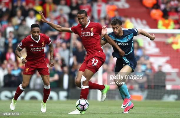 Joel Matip of Liverpool and Rdy Gestede of Middlesbrough battle for possession during the Premier League match between Liverpool and Middlesbrough at...