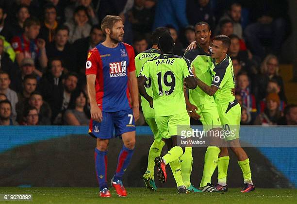 Joel Matip of Liverpool celebrates with team mates after scoring his team's third goal of the game during the Premier League match between Crystal...