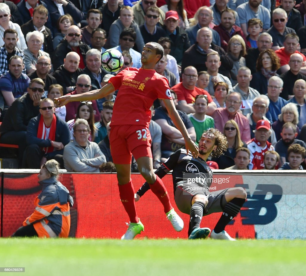Joel Matip of Liverpool competes with Martin Caceres of Southampton during the Premier League match between Liverpool and Southampton at Anfield on May 7, 2017 in Liverpool, England.