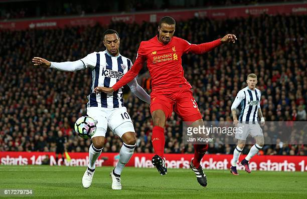 Joel Matip of Liverpool competes with Matt Phillips of West Bromwich Albion during the Premier League match between Liverpool and West Bromwich...
